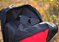 Sunglass with travel bag background photograph beautiful kept on a bags top Stock Photo