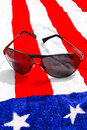 Sunglasses on american flag Royalty Free Stock Photography