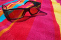 Sunglasses on beach towel Royalty Free Stock Photo