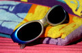 Sunglasses on beach towel Royalty Free Stock Photography
