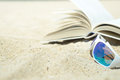 Sunglasses and book on the beach Royalty Free Stock Photo