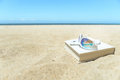 Sunglasses, book and phone on the beach Royalty Free Stock Photo