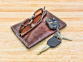 Sunglasses and car keys with leather wallet Royalty Free Stock Photo