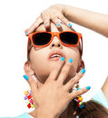 Sunglasses close up hands and face of beautiful young girl in over on white background Stock Photography