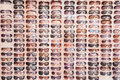 Sunglasses on display on the market offered to tourists and visitors of streets of zadar croatia reflection of landmarks visible Stock Image