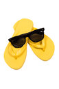 Sunglasses and flip flops on white background sunglasses and flip flops on white background vertical shot of yellow a Stock Image
