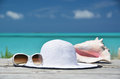 Sunglasses hat and conch against ocean exuma bahamas Stock Images