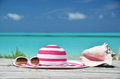 Sunglasses hat and shell against ocean exuma bahamas Royalty Free Stock Photos