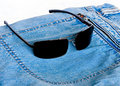 The Sunglasses and jeans Royalty Free Stock Images