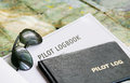 Sunglasses and logbook Stock Photography