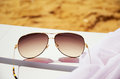 Sunglasses on a lounger and sand horizontal Stock Images
