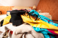 Sunglasses on pile of clothes in suitcase closeup photo Stock Photo