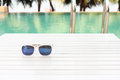 Sunglasses by the pool Royalty Free Stock Photo