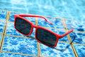 Sunglasses poolside in summer Royalty Free Stock Photo