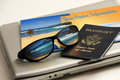 Sunglasses reflect a carribean beach vacation trip an exotic caribbean in the near future with international passport cruise Stock Photos