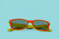 Sunglasses in retro style on blue background Royalty Free Stock Images