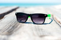 Sunglasses at the seaside sanglasses beach vacation stylish and protect your eyes from bright sun Royalty Free Stock Image