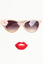 Sunglasses with strawberry lips Royalty Free Stock Photo