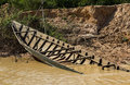 Sunken boat in rusty water