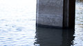 Sunken concrete pillar a stands in frigid waters Royalty Free Stock Images
