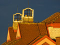 Sunlight on a building roof against dark blue sky after rain in Belgrade Royalty Free Stock Photo