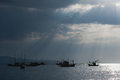 Sunlight through the clouds, a fishing boat, Royalty Free Stock Photo
