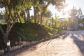 Sunlight on cobblestone road in the morning. old stone texture Royalty Free Stock Photo