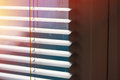 Sunlight coming through venetian blinds by the window Royalty Free Stock Photo