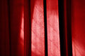 Sunlight falls on a theater curtain Royalty Free Stock Photo