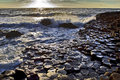 Sunlight highlighting the hexagonal basalt slabs of giants causeway antrim coastline northern ireland is Royalty Free Stock Images
