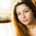 Sunlight and one beautiful sensual young woman Royalty Free Stock Photography