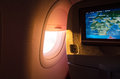 Sunlight from the porthole airplane stock image photos of cabin window and seat monitor Stock Photos