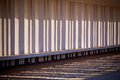 Sunlight and shadows through columns of building horizontal shot Stock Photo