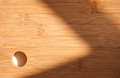 Sunlit cutting board with shadow play shot from above Stock Images