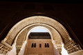 Sunlit decorative entry arch to the courtyard Royalty Free Stock Photo