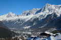 Sunlit valley of chamonix in winter is the middle high snow mountains under the blue sky is a popular sports resort Royalty Free Stock Photography