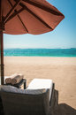 Sunlounger on a tropical beach and towels Royalty Free Stock Image
