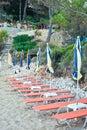 Sunloungers row of on a beach in greece Stock Photos