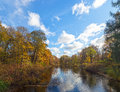 Sunny autumn landscape in park with a small river Stock Image