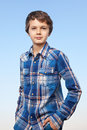 Sunny boy a teenage is making a cool pose and is smiling friendly into the camera Royalty Free Stock Photography