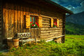 Sunny day into the alps with a traditional house detail Stock Photo