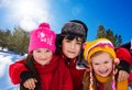 On a sunny day go with friends outside three diversity looking kids two girls and boy winter Stock Image