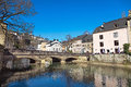 Sunny day in luxembourg march area called grund with the river alzette a popular place for locals and tourists march Stock Image