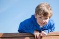 Sunny day young boy looking abajo Fotos de archivo