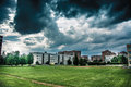 Sunny field in city summer town with epic clouds and massive sky Royalty Free Stock Images