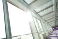 Sunny on glass office windows building interior corridor Royalty Free Stock Photo
