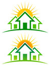 Sunny home logo a icon set of a row of houses with a sun behind them Stock Image