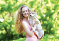 Sunny portrait charming pretty girl and her loving dog outdoors