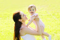 Sunny portrait happy mother and baby having fun in summer Royalty Free Stock Photo