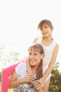 Sunny portrait in park a lifestyle mum with daughter funny pastime at the outdoor Royalty Free Stock Image